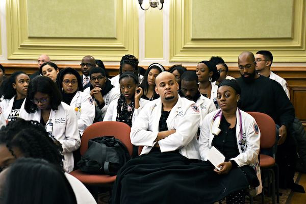 Howard University Medical School students attend a D.C. Council legislative meeting on Dec. 4 to show support of Howard's inclusion in a Ward 8 hospital in northwest D.C. (Roy Lewis/The Washington Informer)