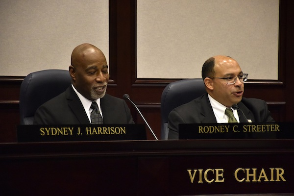 Prince George's County Councilman Todd Turner (right) is unanimously chosen as the board's chair during the council's annual gavel exchange ceremony at the county administration building in Upper Marlboro on Dec. 4. The board also chose Rodney Streeter (left) as vice chair. (Robert Roberts/The Washington Informer)