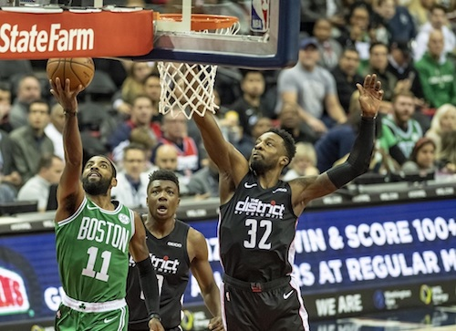 Boston Celtics guard Kyrie Irving attempts a layup against Washington Wizards forward Jeff Green during the Celtics' 130-125 overtime win at Capital One Arena in D.C. on Dec. 12. (Yusuf Abdullah/Special to The Informer)