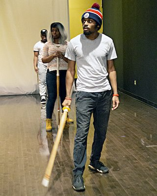 D.J. Abdul-Rahim of Suitland, Maryland, holds a wooden stick during a stage combat lesson at Joe's Movement Emporium in Mount Rainier on Nov. 20. (Courtesy of Joe's Movement Emporium)