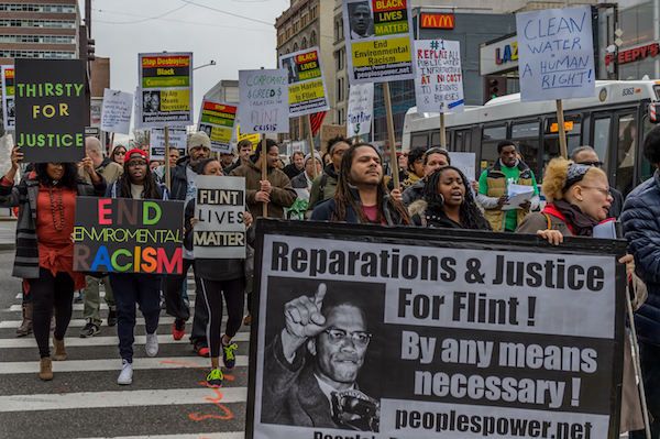 A coalition of NYC Black Lives Matter activists and environmental justice groups marching on the 51st anniversary of the assassination of Malcolm X to demand justice for the people of Flint, Michigan. (Photo by Erik McGregor/Pacific Press/LightRocket via Getty Images)
