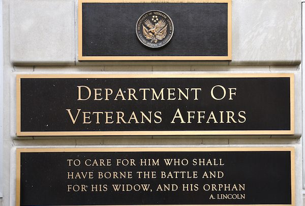 **FILE** A metal plaque on the facade of the Department of Veterans Affairs building in Washington, D.C., features a quotation by Abraham Lincoln. (Photo by Robert Alexander/Getty Images)