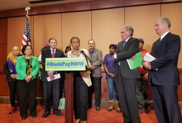 D.C. Delegate Eleanor Holmes Norton (at podium) briefly explains proposed legislation to offer federal contract workers back pay during a Jan. 29 press conference at the U.S. Capitol Visitor Center in D.C. (William J. Ford/The Washington Informer)
