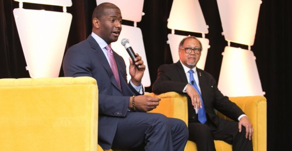 Former Tallahassee Mayor and Florida gubernatorial candidate Andrew Gillum (left) speaks during National Newspaper Publishers Association's (NNPA) annual Midwinter Training Conference at the Hilton Orlando Hotel on Jan. 24 in Orlando as NNPA Chair Benjamin F. Chavis Jr. looks on. (Courtesy of NNPA Newswire)