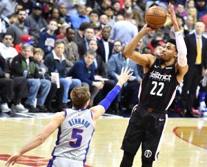 Washington Wizards forward Otto Porter Jr. shoots over Detroit Pistons forward Luke Kennard during the Wizards' 101-87 win at Capital One Arena in D.C. on Jan. 21. (John E. De Freitas/The Washington Informer)