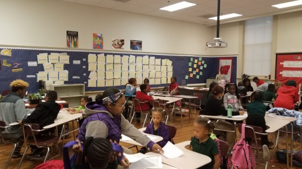 "Every Wednesday after school, Thurgood Marshall Academy students serve as mentors to students in grades two through five and participate in an ""Academic Power Hour."" (Courtesy of TMA)"