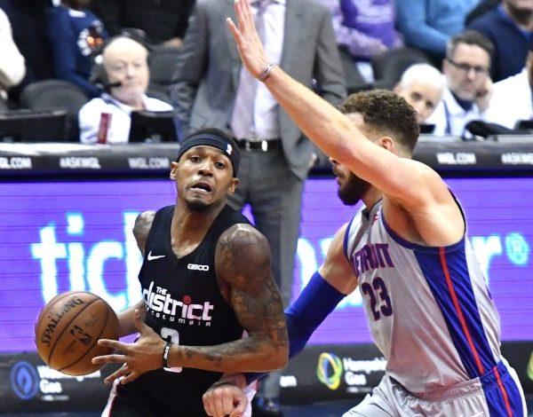Washington Wizards guard Bradley Beal drives against Detroit Pistons forward Blake Griffin during the Wizards' 101-87 win at Capital One Arena in D.C. on Jan. 21. (John E. De Freitas/The Washington Informer)