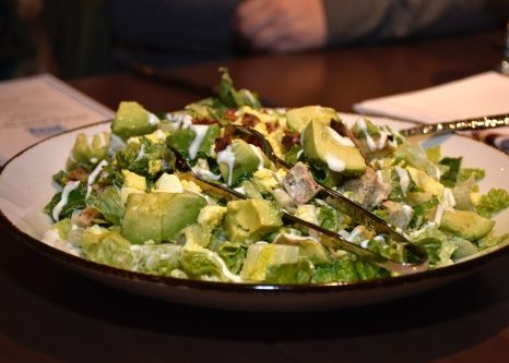 Chopped salad with eggs, bleu cheese, bacon, chicken, avocado, red onions and ranch dressing at The Delegate in the Marriott Courtyard/Residence Inn in the Shaw/Convention Center area, seen here on Jan. 8 (Robert Roberts/The Washington Informer)