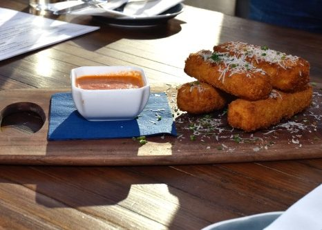 Gruyere and chive grit fries appetizer served with a creole tomato sauce at Due South in the Navy Yard/Capitol Riverfront area in D.C., seen here on Jan. 8 (Robert Roberts/The Washington Informer)
