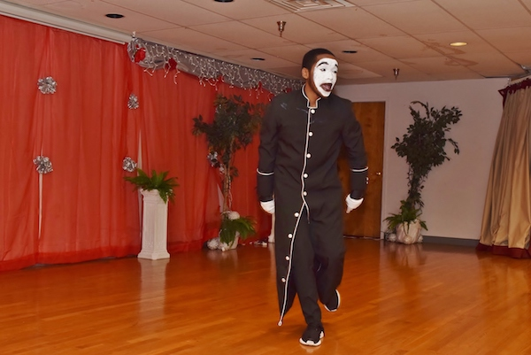Blake Myles Hopkins performs a mime routine at a King holiday prayer breakfast held at Matthews Memorial Baptist Church in southeast D.C. on Jan. 12. (Courtesy photo/Maurice G. Fitzgerald)