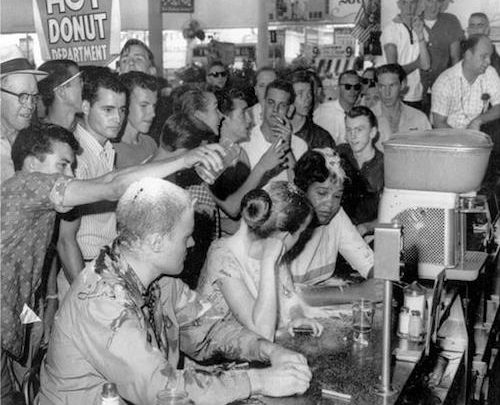 """John """"Hunter Bear"""" Gray and Tougaloo College students being attacked during a lunch counter protest in Jackson, Miss., demonstrate the quiet courage of nonviolence. (Courtesy photo)"""