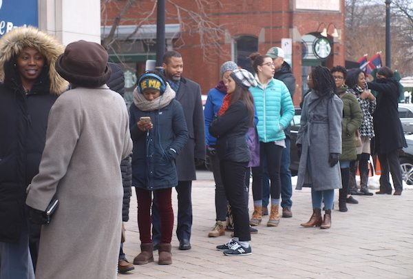 Lines of furloughed federal employees snake downtown D.C. for blocks. (Shantella Y. Sherman/The Washington Informer)