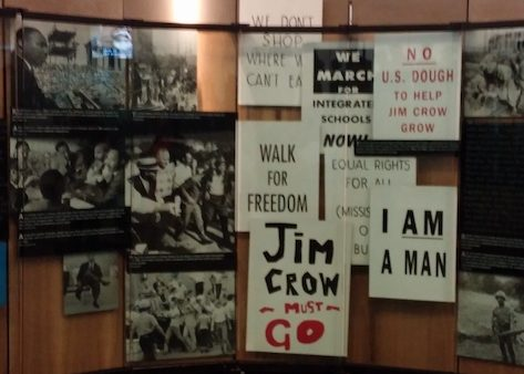 An exhibit at the King Center showcases the many signs utilized during civil rights marches. (Shantella Y. Sherman/The Washington Informer)