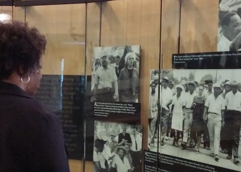 A visitor to the King Center looks at period photo collection of marchers. (Shantella Y. Sherman/The Washington Informer)
