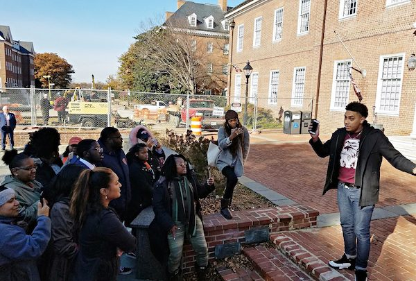 Jose Garcia (right), a student at the University of Maryland Eastern Shore, speaks during a Dec. 8 rally in Annapolis to support full and equal funding for his and the state's three other historically Black colleges and universities. (William J. Ford/The Washington Informer)