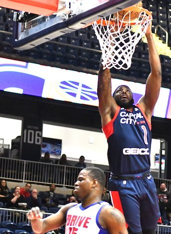 Capital City Go-Go guard Devin Sweetney attempts a dunk during a 115-111 loss to the Grand Rapids Drive at St. Elizabeths East Entertainment and Sports Arena in D.C. on Jan. 27. (John E. De Freitas/The Washington Informer)