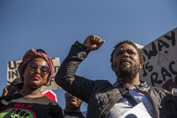 **FILE** Black Land First (BLF) members led by Andile Mngxitama and Zanele Lwaini protests outside MiWay Insurance headquarters following an allegedly fake email scandal on July 21, 2017 in Centurion, South Africa. BLFs visit sought to get clarity on the company's stand on racism after a viral screenshot of an email purportedly between MiWay officials, saying that the company had decided to reject 90% of the claims from black people, referring to them as baboons. MyWay issued a statement declaring the email as fake. CEO Rene Otto, who met with BLF leaders, said they have enlisted the help of an independent forensic expert after an internal probe linked the fake email to a disgruntled client. (Photo by Alet Pretorius/Gallo Images/Getty Images)