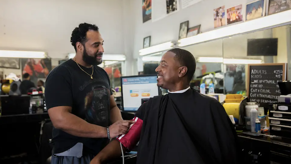 Barber Eric Muhammad (left) and customer Mark Sims (Smidt Heart Institute at Cedars-Sinai)