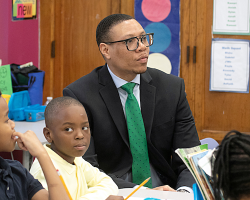 Dr. Lewis Ferebee visits a classroom at Ann Beers Elementary School in Southeast. (Shevry Lassiter/The Washington Informer)