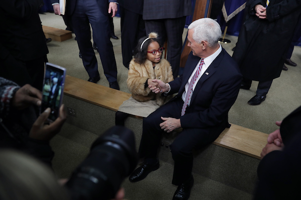 Vice President Mike Pence shakes hands with 4H member Rayan Bundy, 7, of Loudoun, Maryland, after the signing ceremony for the Agriculture Improvement Act in the South Court Auditorium of the Eisenhower Executive Office Building Dec. 20, 2018 in Washington, D.C. Designed to go through the 2023 crop year, this farm bill is the first since 1990 that was enacted within the year for which programs were authorized. (Photo by Chip Somodevilla/Getty Images)