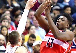 Washington Wizards center Thomas Bryant attempts a short jumper over Atlanta Hawks center Alex Len in the first half of the Wizards' 114-98 win at Capital One Arena in D.C. on Jan. 2. (John E. De Freitas/The Washington Informer)