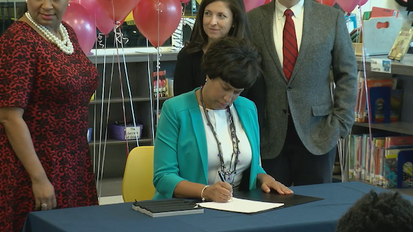 """D.C. Mayor Muriel Bowser signs the """"Love Act."""" (Courtesy of dc.gov)"""