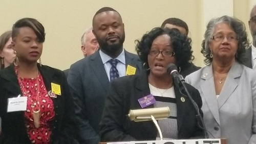 Delegate Diana Fennell (D-District 47A) of Colmar Manor speaks during a Jan. 14 press conference in Annapolis to support legislation to raise the state's minimum wage to $15 an hour. Fennell will introduce legislation in the House and state Sen. Cory McCray of Baltimore City (second from left) will present similar legislation in the Senate. (William J. Ford/The Washington Informer)