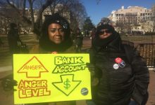 Lavette Lightford and Lori Mac, members of the National Treasury Employees Union, particpate in a Jan. 10 march in D.C. against the government shutdown. (Barrington M. Salmon/TriceEdney News Wire)