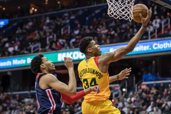 Giannis Antetokounmpo of the Milwaukee Bucks goes to the basket against Otto Porter Jr. of the Washington Wizards during the second half at Capital One Arena in D.C. on Feb. 2. (Scott Taetsch/Getty Images)