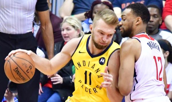 Indiana Pacers forward Domantas Sabonis posts up Washington Wizards forward Jabari Parker during the Pacers' 119-112 win at Capital One Arena in D.C. on Feb. 23. (John E. De Freitas/The Washington Informer)
