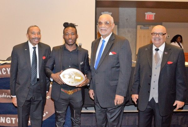 Ballou Senior High School student and football standout Lavonte Gater (second from left) is named Defensive Player of The Year by the Pigskin Club of Washington, Inc., during its 79th annual awards banquet at the Catholic University of America's Edward J. Pryzbyla Center in northeast D.C. on Feb. 15. (Courtesy of the Pigskin Club of Washington, Inc.)