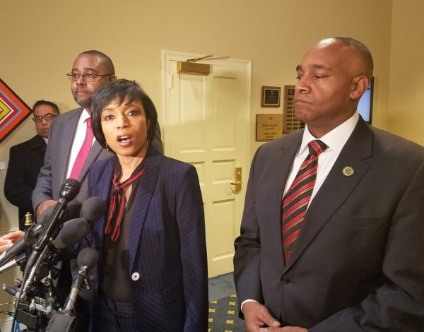 Prince George's County Executive Angela Alsobrooks (center) speaks with reporters on Feb. 27 regarding Maryland Del. Mary Ann Lisanti, who came under fire for using a racial slur to describe an area of the county. Standing alongside Alsobrooks are Dels. Darryl Barnes (left) and Michael Jackson. (William J. Ford/The Washington Informer)