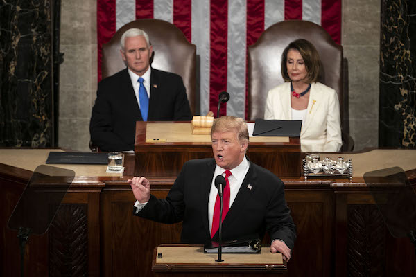 U.S. President Donald Trump delivers a State of the Union address to a joint session of Congress at the U.S. Capitol in Washington, D.C., U.S., on Tuesday, Feb. 5, 2019. Trump will speak to a House chamber full of Democrats jostling to challenge his re-election, with many female lawmakers planning to dress in suffragette white and his chief antagonist Nancy Pelosi seated at the dais behind him. Photographer: Al Drago/Bloomberg via Getty Images