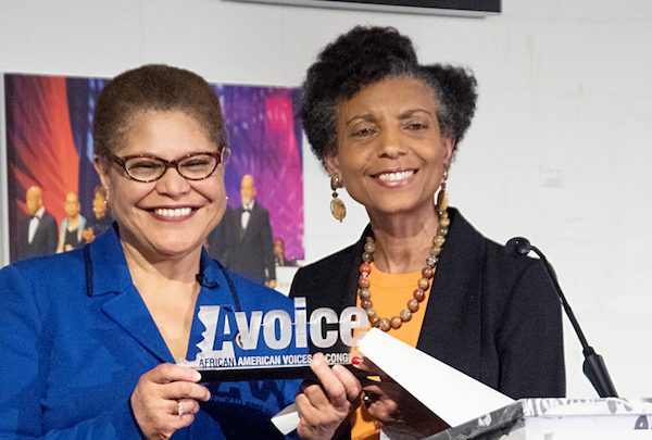Elsie Scott, interim president and CEO of the Congressional Black Caucus Foundation, Inc., presents the Distinguished Champion for Global Black Empowerment award to Congressional Black Caucus Chair Karen Bass (D-Calif.) during the 2019 Avoice Heritage Celebration in northwest D.C. on Feb. 26. (Shevry Lassiter/The Washington Informer)