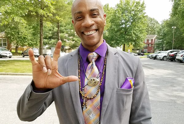 """Rev. Raymont Anderson says the word """"heaven"""" in American Sign Language. (Jacqueline Fuller/The Washington Informer)"""