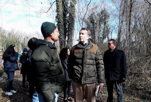 **FILE** Newly inaugurated Virginia Gov. Ralph Northam joins community workers who spent the MLK birthday on Jan. 15 sprucing up the historic Evergreen Cemetery in Richmond, which serves as the final resting place for many prominent African Americans. (Dorothy Rowley/The Washington Informer)