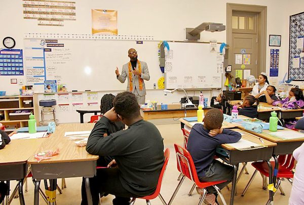 Duvalier Malone speaks to the students at Democracy Prep Congress Heights Public Charter School for the kickoff of Black History Month. (Courtesy of Democracy Prep PCS via Facebook)