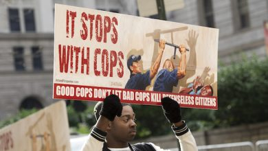 **FILE** A demonstrator holds a sign during the trial of Police Officer William Porter at Baltimore City Circuit Courthouse on December 16, 2015. (Molly Riley/AFP/Getty Images)