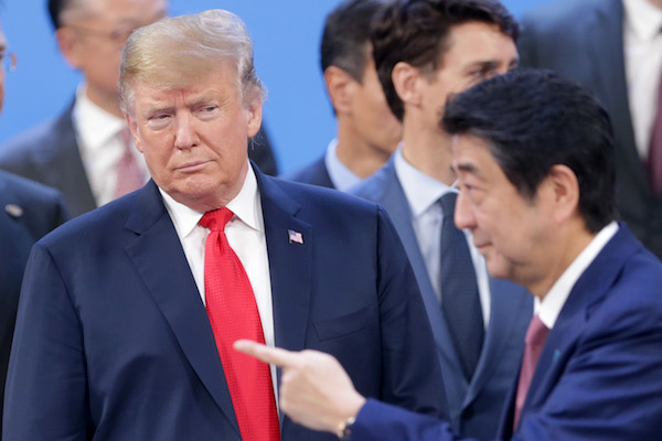 **FILE** U.S. President Donald Trump looks at Prime Minister of Japan Shinzo Abe after the family photo on the opening day of Argentina G20 Leaders' Summit 2018 at Costa Salguero on Nov. 30, 2018. (Daniel Jayo/Getty Images)