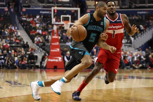 Nicolas Batum of the Charlotte Hornets dribbles past Trevor Ariza of the Washington Wizards during the first half at Capital One Arena on March 15, 2019 in Washington, D.C. (Patrick Smith/Getty Images)
