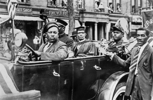 Marcus Mosiah Garvey, Jr., National Hero of Jamaica and leader of the Back to Africa movement sits in the back of a car in a parade through Harlem circa 1920 in New York City, New York. (Photo by Michael Ochs Archives/Getty Images)