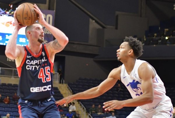 Capital City Go-Go forward Tyler Lydon looks to shoot over Delaware Blue Coats guard Rashad Vaughn during the Blue Coats' 125-111 victory in D.C. on March 8. (John De Freitas/The Washington Informer)