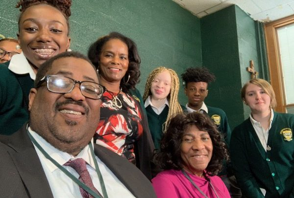 Georgia Dunston (seated, center) and Cherie Ward (standing in rear) with Archbishop Carroll High School students (Hamil R. Harris/The Washington Informer)