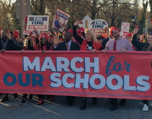 Alvin Thornton (center), chair of Prince George's County school board, helps hold a banner during a March 11 rally in downtown Annapolis for increased education funding. (William J. Ford/The Washington Informer)