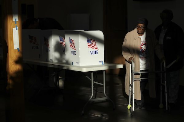 A voter exits after casting her ballot at a polling place at Highland Colony Baptist Church, November 27, 2018, in Ridgeland, Mississippi. Voters in Mississippi head to the polls for today's special runoff election, where Democratic candidate for U.S. Senate Mike Espy is running in a close race with appointed Republican Senator Cindy Hyde-Smith (R-MS). (Photo by Drew Angerer/Getty Images)
