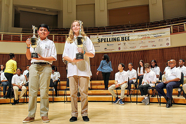 Alyssa Burgos (right), an eighth-grader at Holy Redeemer, was the winner of the 2019 Prince George's County Spelling Bee while Shree Ruttala, a seventh-grader at Hyattsville Middle School, came in second at the Clarice Smith Performing Arts Center in College Park on March 15. (Brigette White/The Washington Informer)