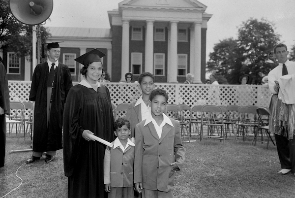 University of Maryland School of Law graduate Juanita Jackson Mitchell in cap and gown with her sons Clarence M. Mitchell III, Keiffer Mitchell and Michael Bowen Mitchell at the university's College Park campus (Paul Henderson/Maryland Historical Society)