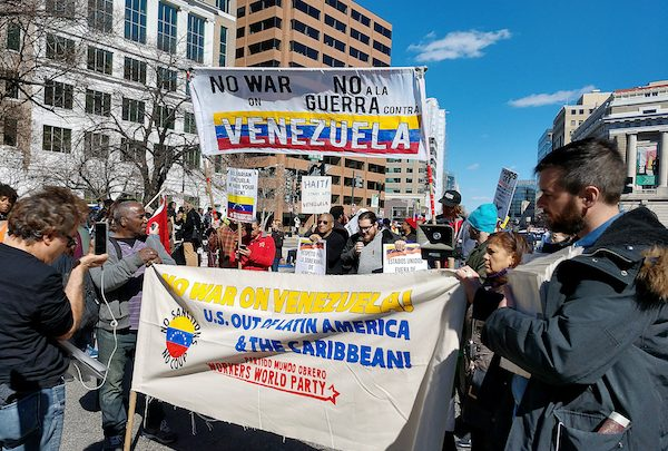 Protesters opposed to U.S. intervention into Venezuela marched to the Trump Hotel after a rally at Lafayette Square across from the White House on March 16. Speakers called on the Trump administration to use peaceful means to resolve the political, social and economic crisis in Venezuela instead of military force. (Barrington M. Salmon/Special to The Informer)