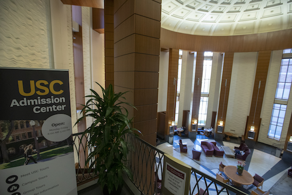 A view of the entrance to the USC Admission Center in the Ronald Tutor Campus Center at the University of Southern California in Los Angeles, Calif., on March 12, 2019. Federal prosecutors say their investigation dubbed Operation Varsity Blues blows the lid off an audacious college admissions fraud scheme aimed at getting the children of the rich and powerful into elite universities. According to prosecutors, wealthy parents paid a firm to help their children cheat on college entrance exams and falsify athletic records of students to enable them to secure admission to schools such as UCLA, USC, Stanford, Yale and Georgetown. Two USC athletic department employees ? a high-ranking administrator and a legendary head coach ? were fired Tuesday after being indicted in federal court in Massachusetts for their alleged roles in a racketeering conspiracy that helped students get into elite colleges and universities by falsely designating them as recruited athletes. (Allen J. Schaben/Los Angeles Times via Getty Images)