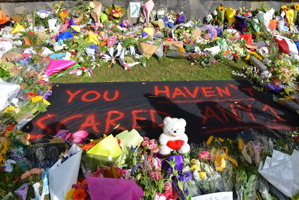 Flowers and condolences are seen near Masjid Al Noor Mosque during a public vigil, close to the shooting area, in Christchurch, New Zealand on March 20, 2019. At least 50 people were reportedly killed in twin terror attacks targeting mosques in Christchurch, New Zealand, an official said on Friday. Witnesses claim the Al Noor Mosque was targeted by armed assailants and there were up to 200 people inside for Friday Prayers. (Photo by Recep Sakar/Anadolu Agency/Getty Images)